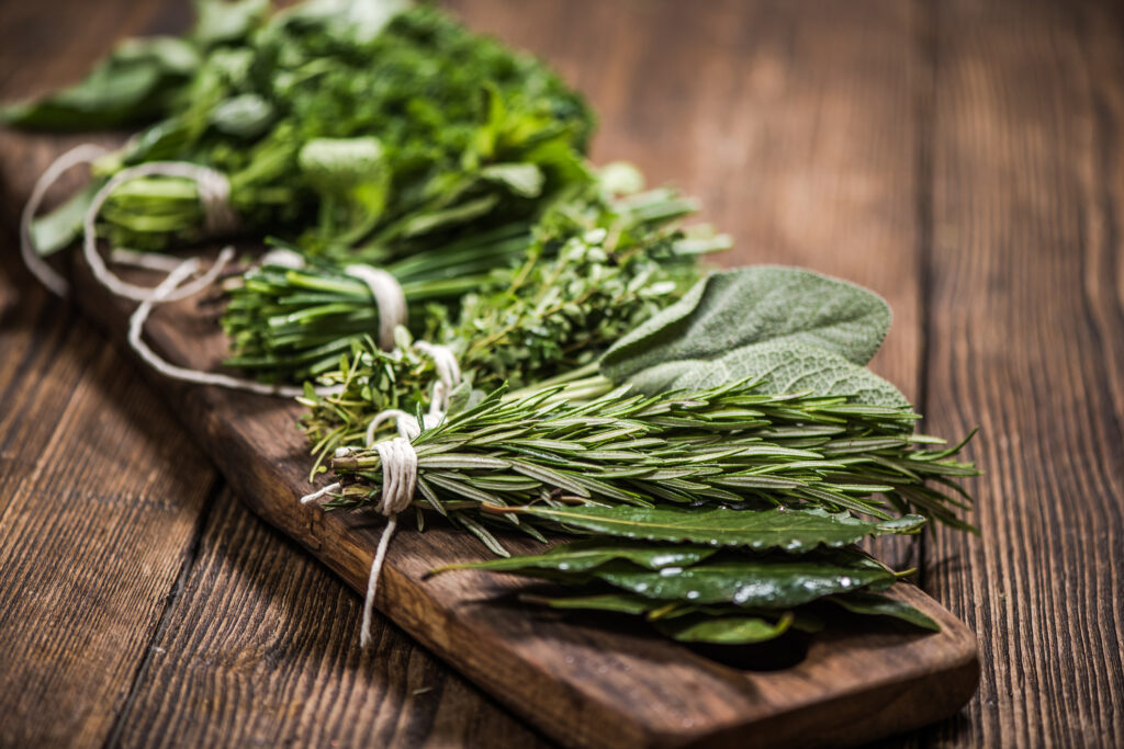 natural aromatic herbs on wooden board