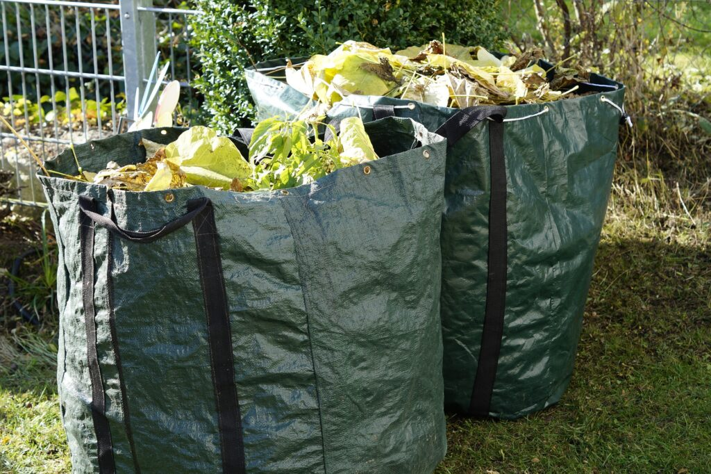 Two green bags of garden waste